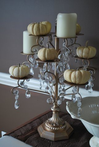 Candleabra with pumpkins and candles