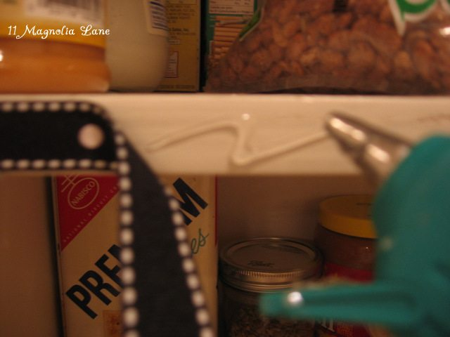 glue gun ribbon to shelf edges for a decorative effect