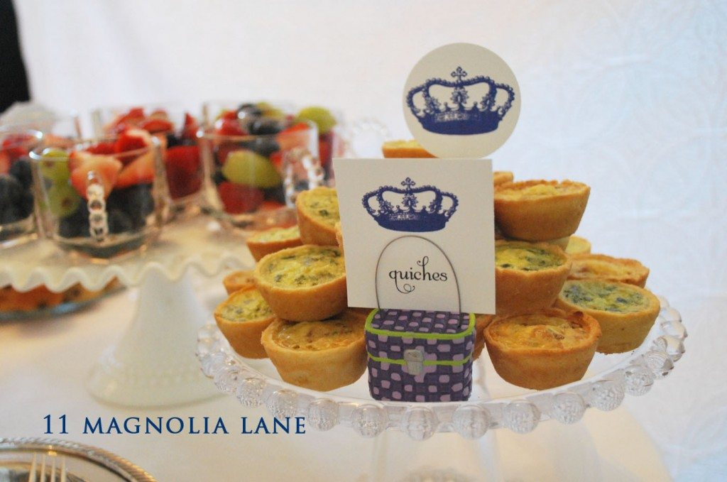 Quiche, and fruit served in the glass teacups that match the plates