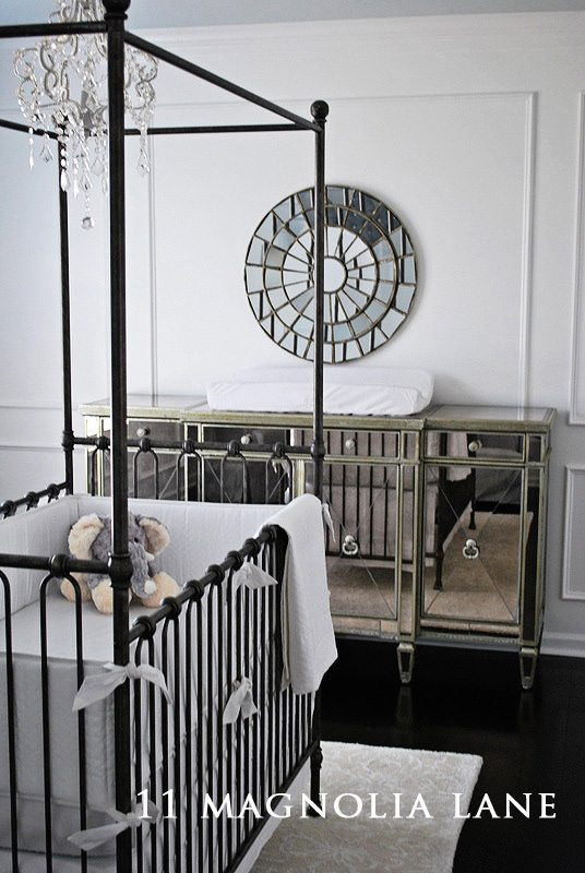 Beautiful moldings, Restoration Kids bedding and mirrored furniture create a magical space for a little girl.