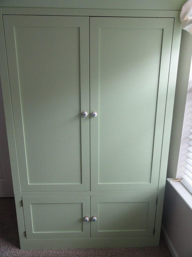 Entertainment center painted pale apple green