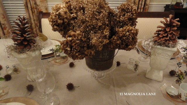 A natural thanksgiving tablescape pine cones berries