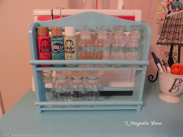 spice rack to organize acrylic paint bottles