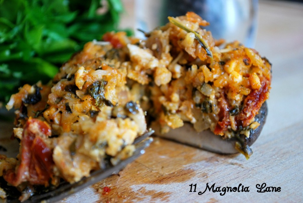 Stuffed Portabella Mushroom overflowing with Spinach, Sundried Tomato, Feta and rice filling.