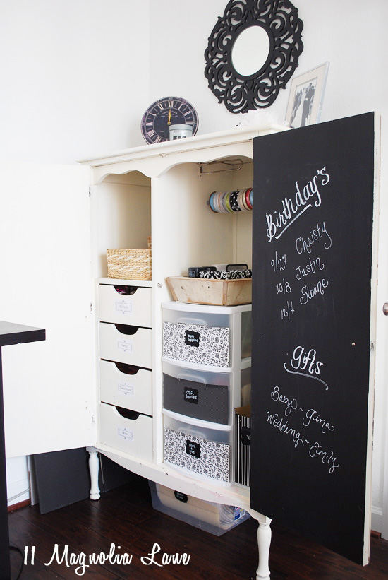 Armoire repurposed as organized gift wrapping station