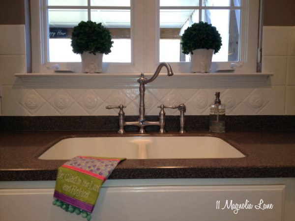 painted ceramic tile backsplash in my kitchen a year