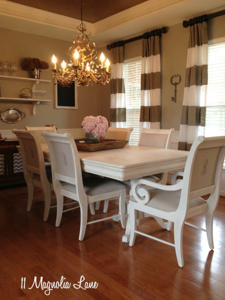 Dining room with painted table and chairs at 11 Magnolia Lane