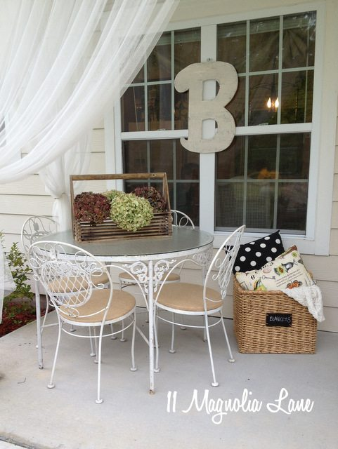 chippy white iron table and burlap seat cushions