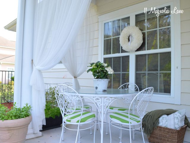Green and white striped fabric on covered porch | 11 Magnolia Lane