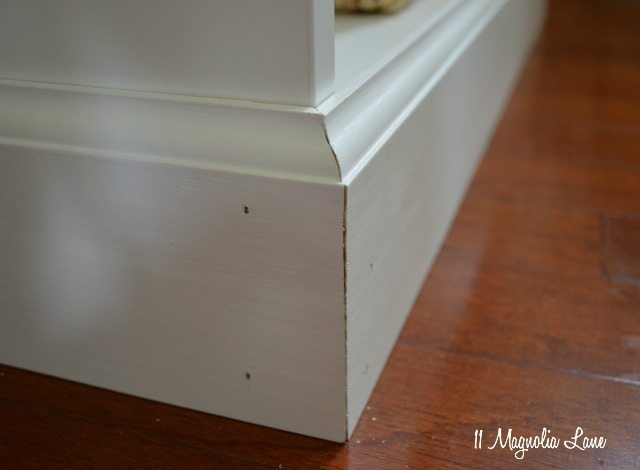 The next step is to add lattice moulding to the top of the bookcases