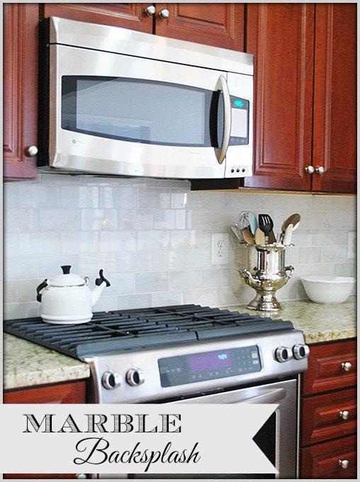 installing a new cararra marble tile backsplash in the kitchen 11