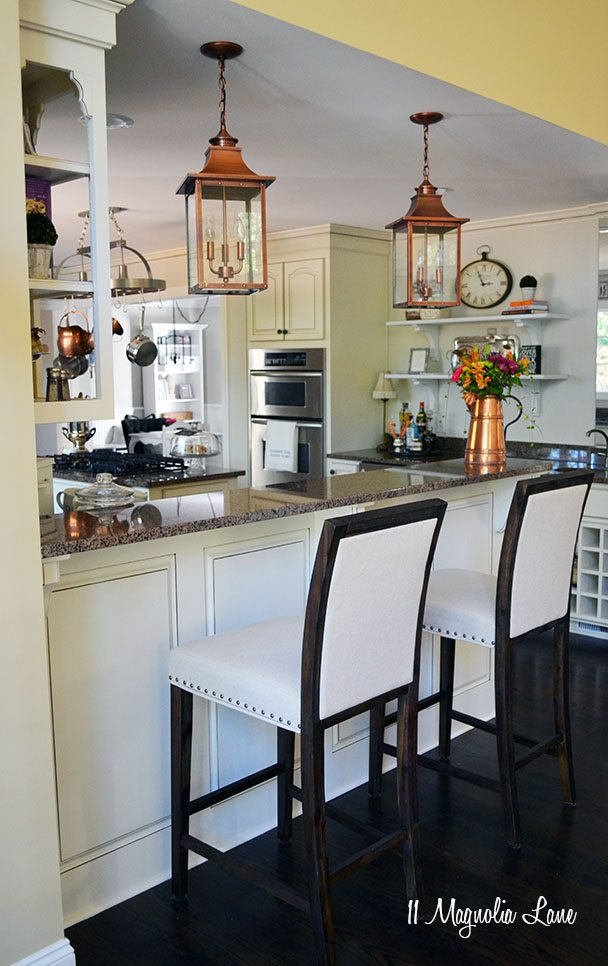 French Country Kitchen With Off White Cabinets And Copper Accents