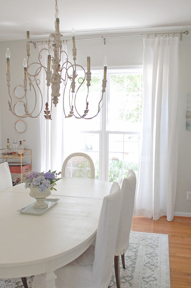 Dining Room With White Furniture And Gray Walls Linen Curtains
